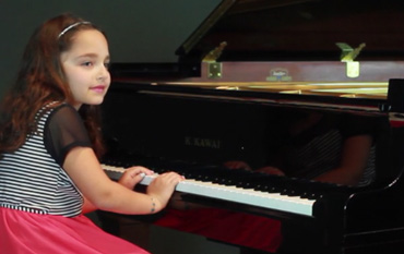 Piano Student Plays Minuet in G